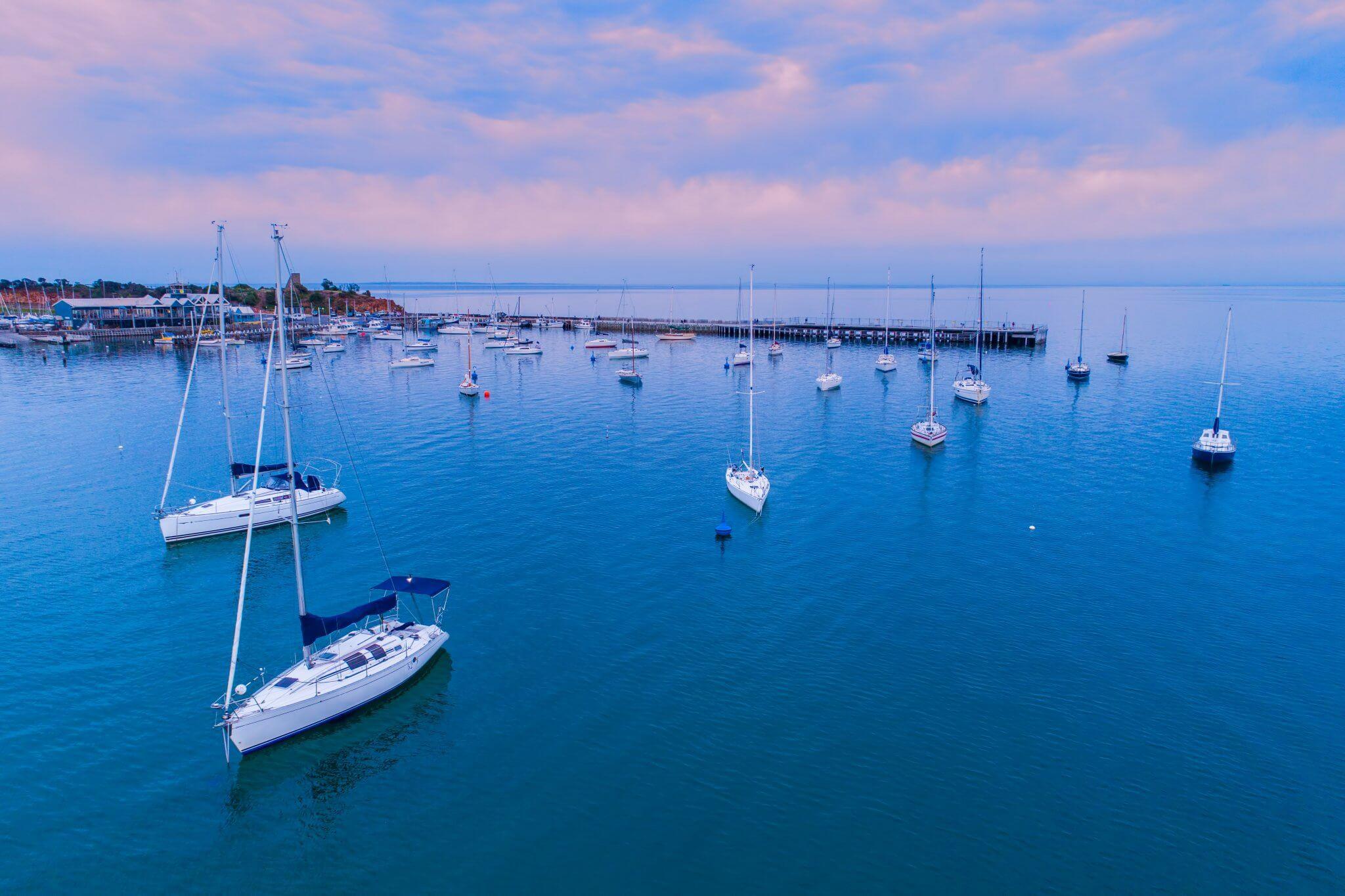 Moored boats near Mornington Pier at sunrise