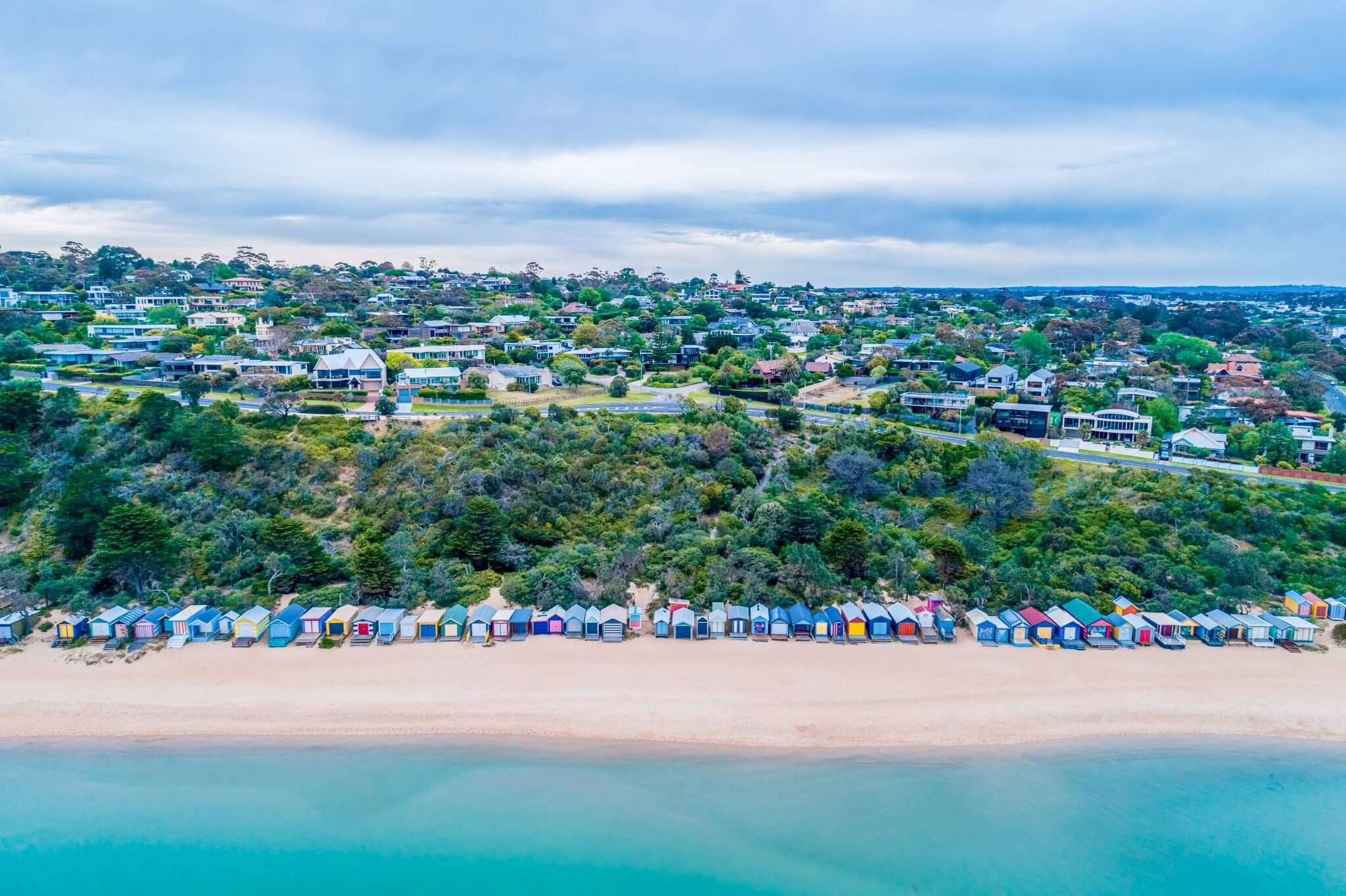 Aerial view of picturesque beach huts on Mills Beach in Mornington, Victoria, Australia